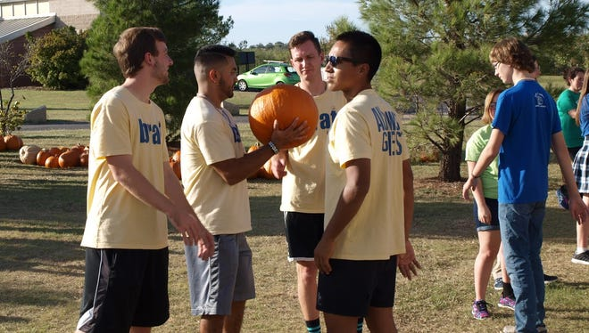 Members of the Frater Sodalis men�s social club at Abilene Christian University help unload pumpkins at the Disability Resources pumpkin patch.