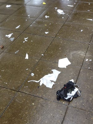 Pieces of the object destroyed by OSP's bomb techs seen on the sidewalk at the Capitol Mall.