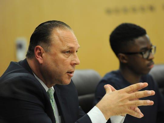 Hackensack Police Director Michael Mordaga speaks during