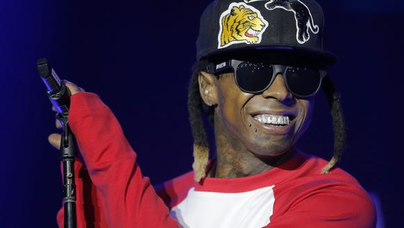 Lil Wayne flashes his grill during his concert Thursday