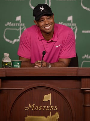 Four-time Masters champion Tiger Woods speaks with the media during a press conference on a practice round day for The Masters golf tournament at Augusta National Golf Club.