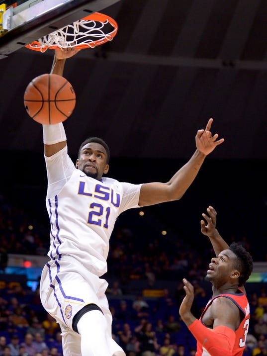LSU forward Aaron Epps (21) dunks the ball over Mississippi guard Terence Davis (3) during the first half of an NCAA college basketball game Saturday, Feb. 10, 2018, in Baton Rouge, La. (Hilary Scheinuk/The Advocate via AP)