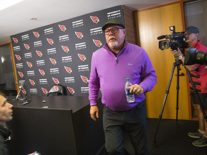 Arizona Cardinals head coach Bruce Arians walks off