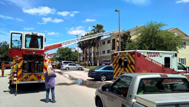 Fire crews work at the scene of a Thursday fire in Viera.