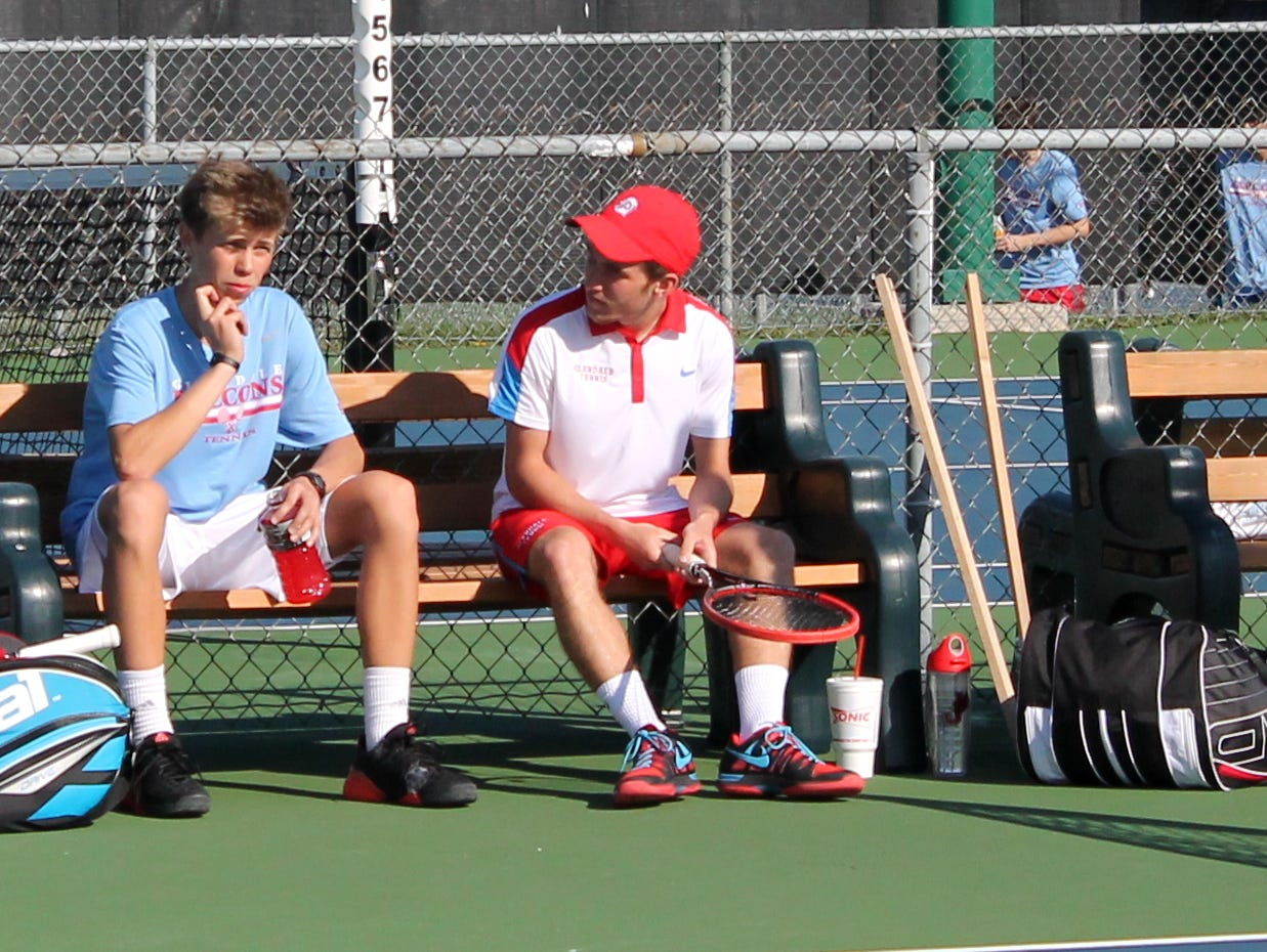 From left, Glendale tennis players Reed Jarvis and Hayden Fulk talk strategy before playing a doubles match against Kickapoo Tuesday, April 5, 2016.