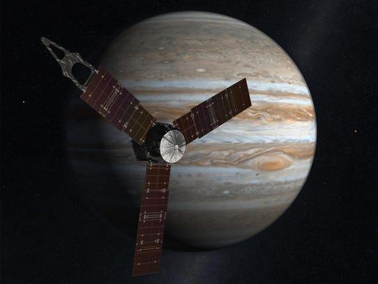 An artist's conception of the Juno spacecraft in orbit