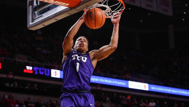 TCU sophomore Desmond Bane dunks the ball late in the game against Iowa State on Wednesday, Feb. 21, 2018, at Hilton Coliseum in Ames. TCU won, 89-83.