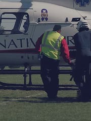 A student was lifted from the scene by medical helicopter