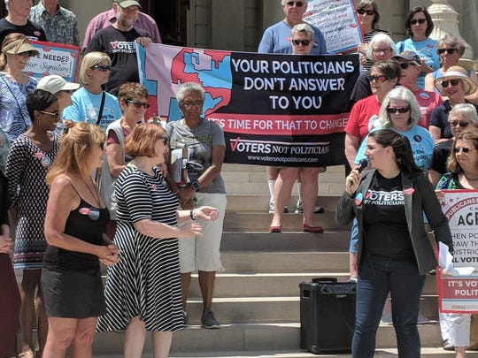 Katie Fahey of Voters Not Politicians speaks to supporters at the Michigan Capitol on May 24, 2018.