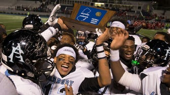 Asbury Park's Josmore Taylor celelbrates their sectional title with teammates. Asbury Park vs Keyport in NJSIAA Central Group I championship football game at Kean University in Union, NJ