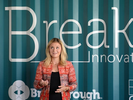 Heather Mueller, vice president of the Breakthrough Fuels, talks about the features of their new offices in the Backstage at the Meyer building.