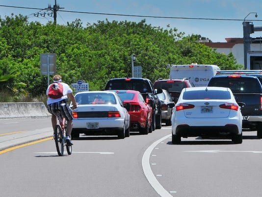 CYCLIST RIDING ON LOCAL ROADS