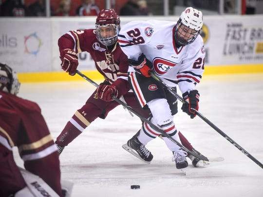 St. Cloud State's Kevin Fitzgerald works against Luke