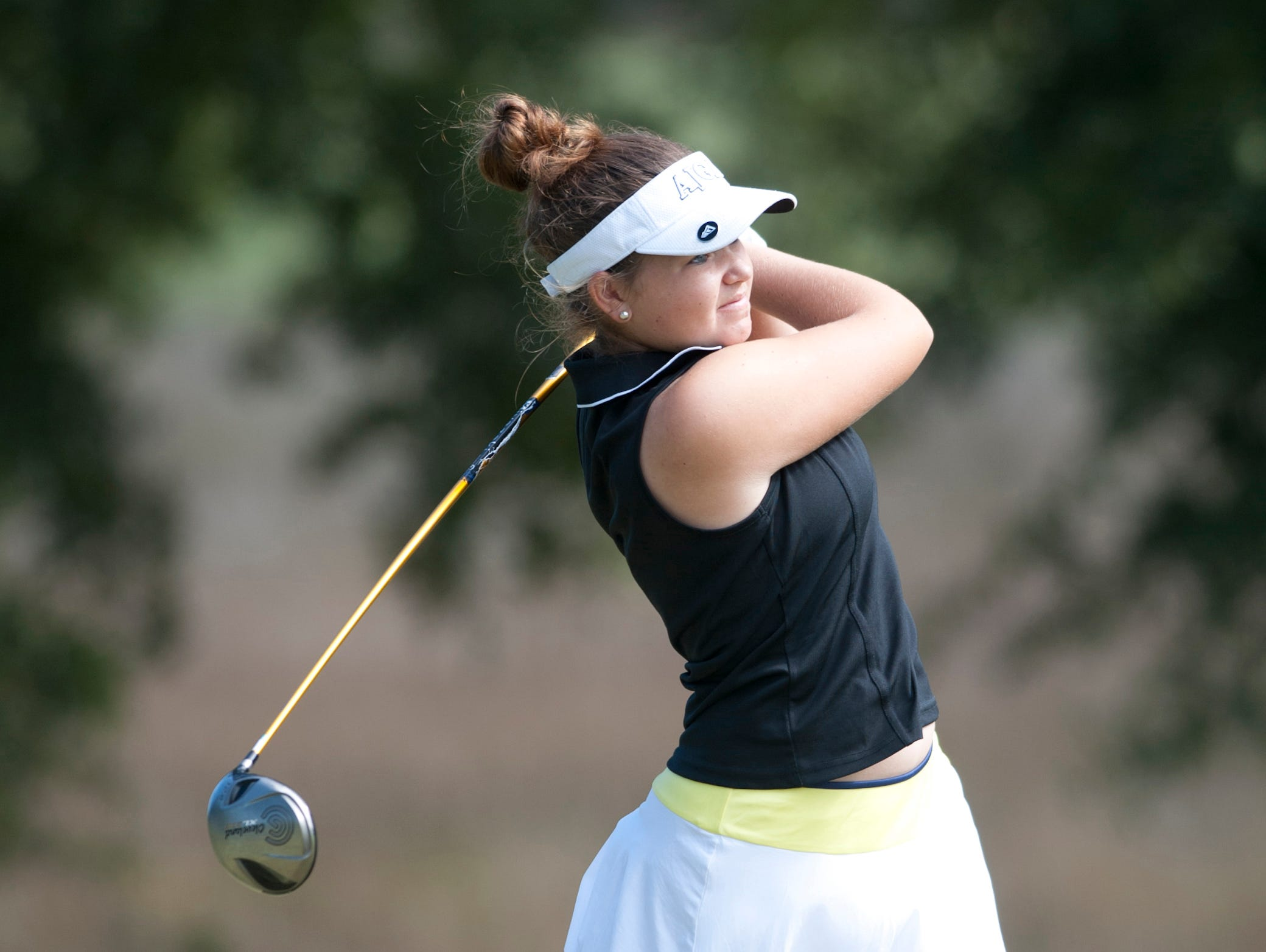 Catholic High School's Abigail Hermann watches the flight of her tee shot during the Fellowship of Christian Athletes girlsâ?? golf classic at A.C. Read Tuesday.