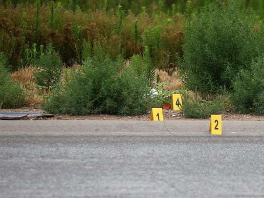 Evidence markers are placed at the site of a fatal hit-and-run crash on a frontage road in the 4500 block Houston Harte Expressway on June 16, 2015.