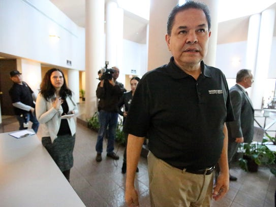 City Rep. Larry Romero walks out of a conference room