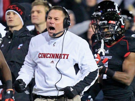 Cincinnati coach Butch Jones cheers on his team after