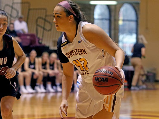 Midwestern State's Whitney Taylor dribbles in the game