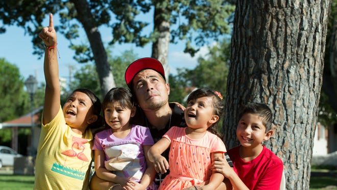 Gabe Chavez, who is a participant in the adult drug court program at 3rd Judicial District Court, sits with his family on Saturday, September 19, 2017, at Pioneer Park. Seated with Chavez from left, Anariel Chavez, 8, daughter, Desiree Chavez, 4, niece, Jenayah Chavez, 4, daughter, and Angel Chavez, 12 nephew. Chavez says the program has helped him turn his life around — staying sober and employed.