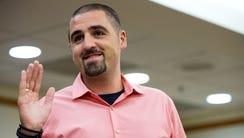 Nick Dugas, 30, is sworn in during an adoption hearing