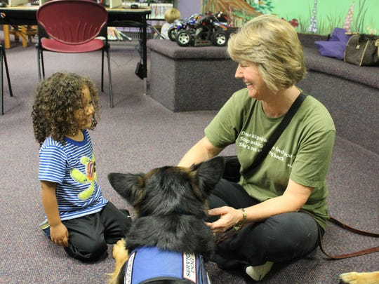 Donna Downs laughs with Noah Boyette, 3, during the Furry Buddies program at the Mays Landing Branch of the Atlantic County Library System on Sept. 6.