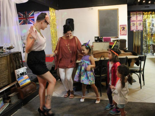 Jillian Gazzara (left), shows some visitors a few dance moves during Third Thursday at the mART.