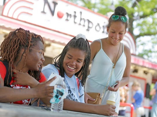 From left, Yaminah Powell, Rosemary Gosseck McNeal and her twin sister, Evelyn Gosseck McNeal, all from Greendale, hang out at Northpoint Custard, on the lakefront in Milwaukee.