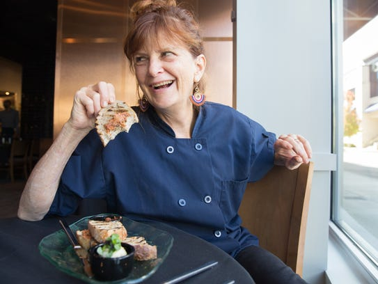 Nashville Chef Deb Paquette munches on bread at etc.,