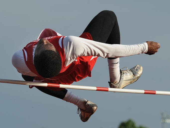"""Jeffersonville's Guy Oliver won the high jump with a height of 6'4"""" at the Boys' Track and Field Sectionals Thursday at Jeffersonville High School. May 22, 2014"""