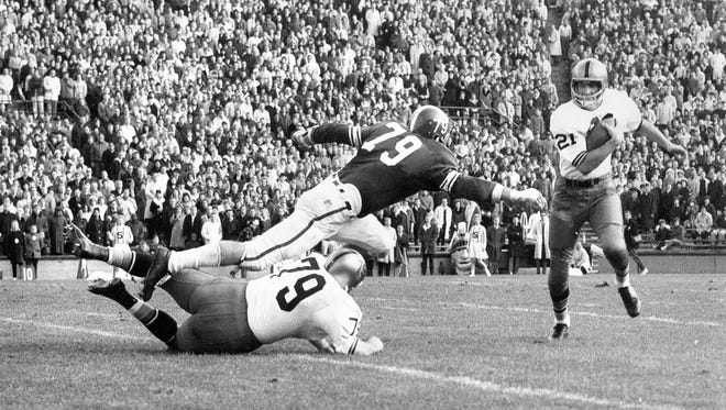 Ed Budde (79 on defense) was an All-American offensive tackle in 1962 before an All-Pro NFL career.