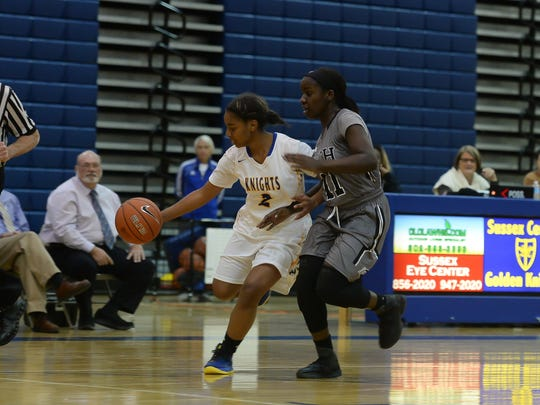 Sussex Central's Azayah Garrison drives to the basket against Sussex Tech on Friday, Dec. 9, 2016 in Georgetown, De.