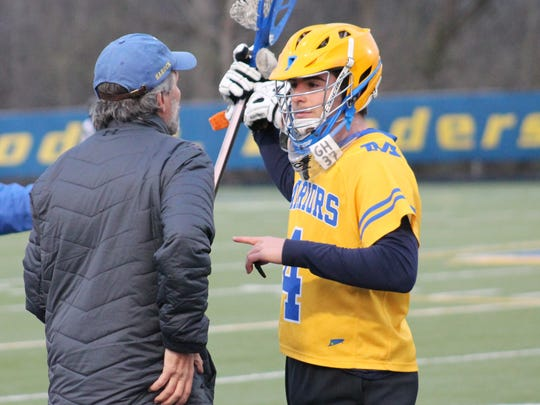 Mariemont senior goalie Dan Cascella gets some instruction from Mariemont assistant coach Graham Harden April 2.  Casceclla wears Harden's initials and number GH 37.