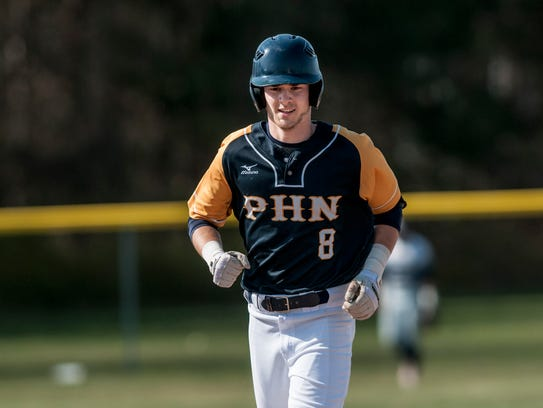 Port Huron Northern's Brett Manis runs the bases after