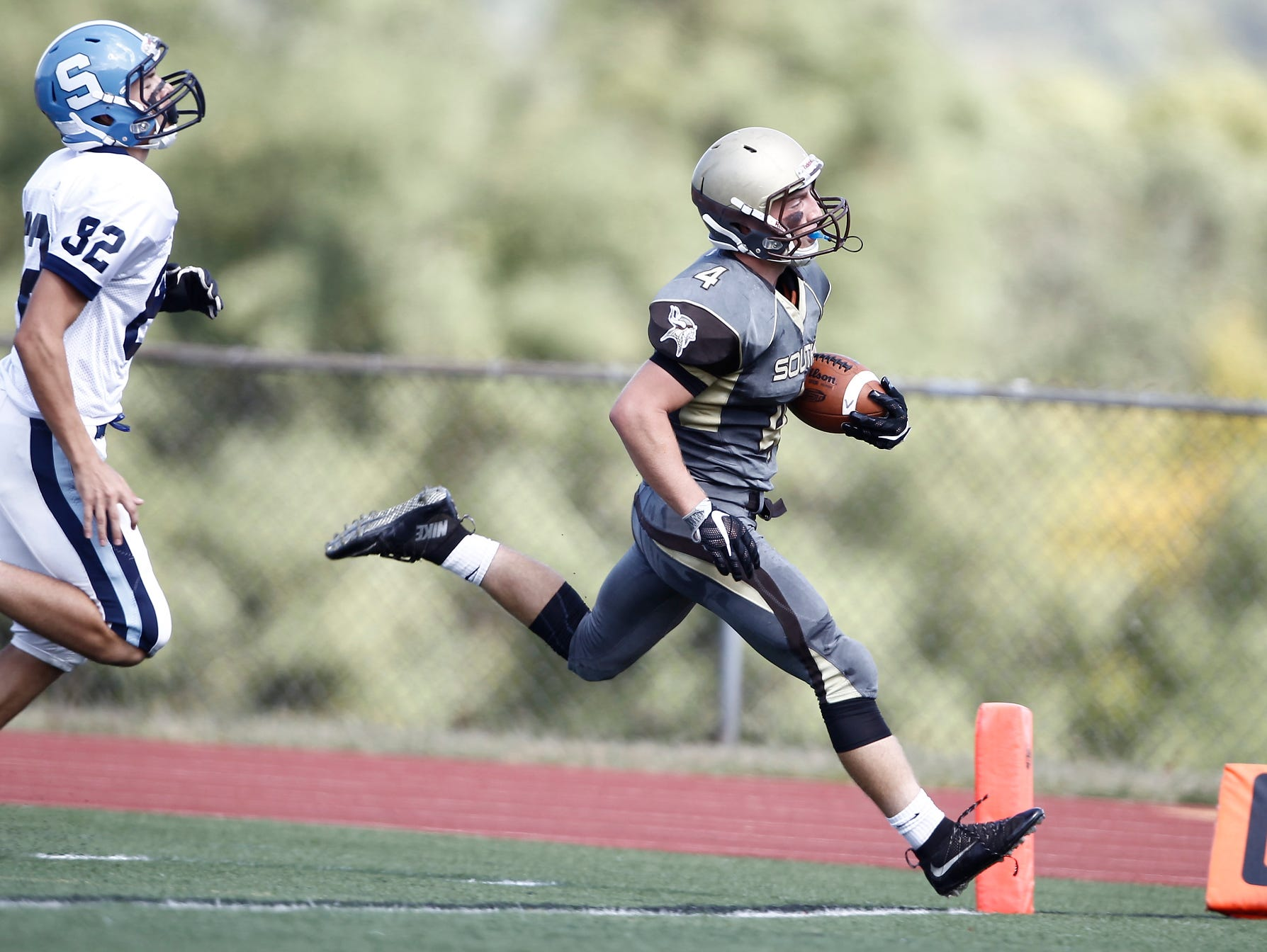 Clarkstown South's Kyle Samuels (4) crosses the goal line during their 30 - 0 win over Suffern at Clarkstown South High School on Saturday, September 17, 2016.
