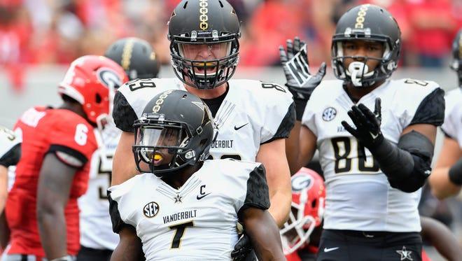 Vanderbilt running back Ralph Webb (7) reacts with teammates after scoring a touchdown against Georgia.
