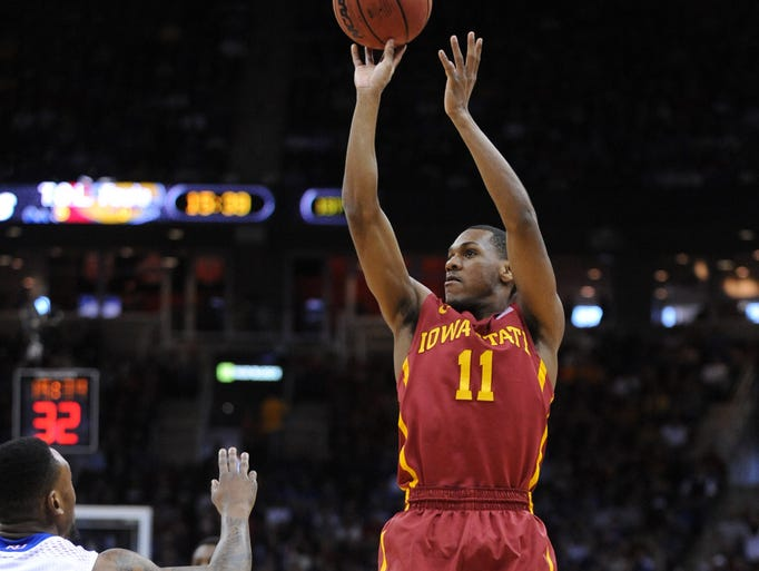Mar 14, 2014; Kansas City, MO, USA; Iowa State Cyclones guard Monte Morris (11) shoots as Kansas Jayhawks guard Naadir Tharpe (10) defends during the first half in the semifinals of the Big 12 Conference college basketball tournament at Sprint Center.