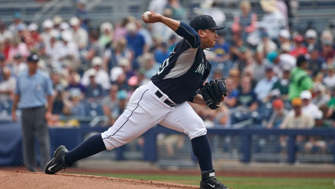 Seattle Mariners starting pitcher Erasmo Ramirez works against the Oakland Athletics in the first inning of a spring training baseball game against the Oakland Athletics Wednesday, March 18, 2015, in Peoria, Ariz.