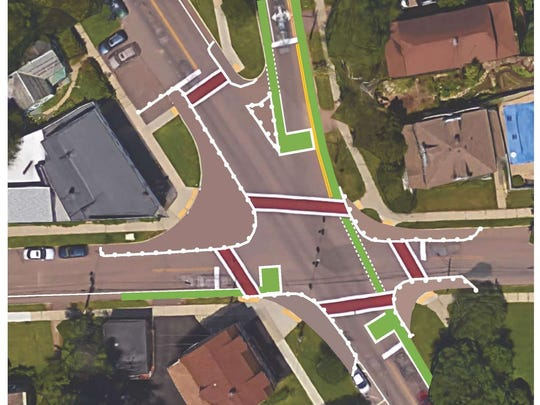 """A proposed re-shaping of the intersection of South Winooski Avenue and Howard and St. Paul streets shows pedestrian-friendly """"bump-outs"""" (white lines with bumps); bicycle-only areas (in green); narrower lanes for motorized traffic; and shorter crosswalks."""