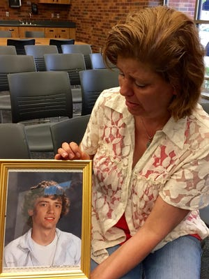 Dawn Van Ballegooyen of Brookings holds a photograph of her son, Brady Folkens, who died in December 2013. He got sick at a state-run institution in Custer, where he had been sent because of truancy and marijuana infractions.