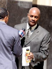 James Hearn, 50, of West Bloomfield, principal at Marcus Garvey Academy. He  is charged with accepting $11,500 in kickbacks from Shy. He is shown here leaving federal court after his plea hearing on May 5, 2016, in Detroit.