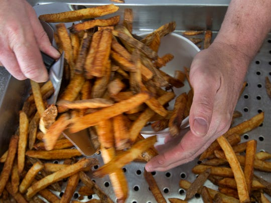 Desmond Hussey of Kuppers French Fries make up a batch
