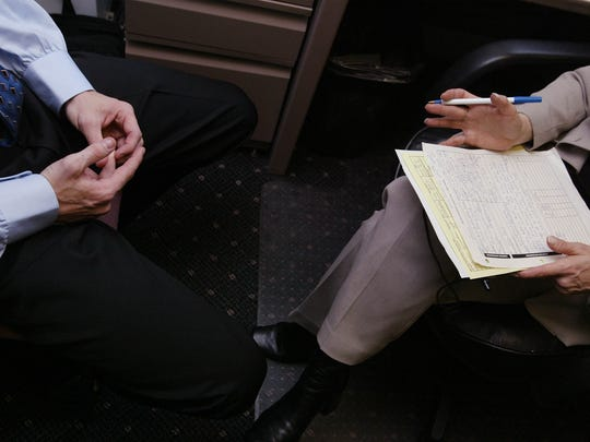 A job applicant speaks with recruiter Renee Chandler during an interview in New York City.