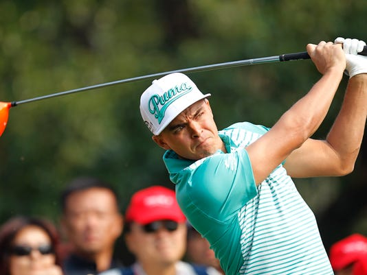 Rickie Fowler of the U.S. tees off on the 14th hole during the first round of the HSBC Champions golf tournament at the Sheshan International Golf Club in Shanghai, China, Thursday, Nov. 6, 2014. (AP Photo)