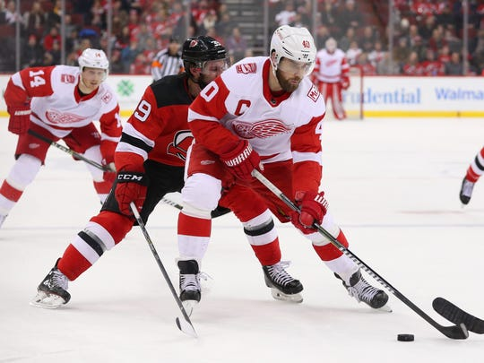 Detroit Red Wings center Henrik Zetterberg (40) skates with the puck during the first period of their game against the New Jersey Devils at Prudential Center.