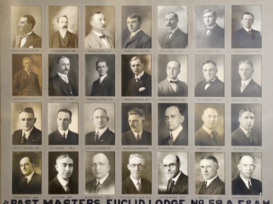 Portraits of past Masters of the Euclid Lodge hand along walls at the Masonic Temple.