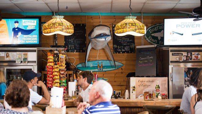 Sharky's lunch crowd dines on pizza, burgers and seafood while patrons at the bar order beer Sunday, June 25, 2018, at 1012 Shorewinds Drive on North Hutchinson Island in St. Lucie County.