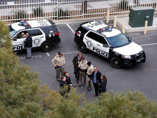 Las Vegas police investigate the vandalism of a billboard