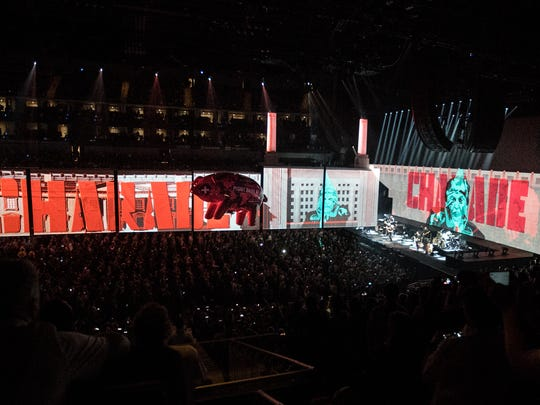 """The performance of """"Pigs"""" on Roger Waters' current tour is highly critical of President Trump, with an inflatable pig bearing a picture of Trump's face on its side floating around the crowd."""