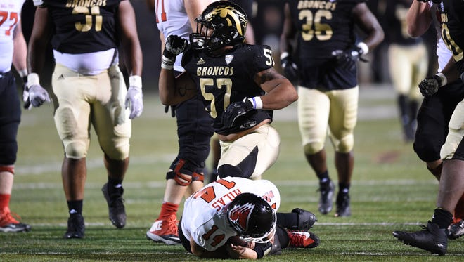 Western Michigan's Ali Fayad (57) celebrates a sack against Ball State on September 30, 2017 at Waldo Stadium in Kalamazoo.