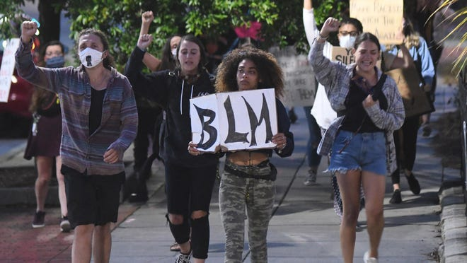 Lily Nicole leads a group of protestors down 3rd St. in downtown Wilmington in June. People have gathered to protest police violence and systemic racism nightly since June 1.